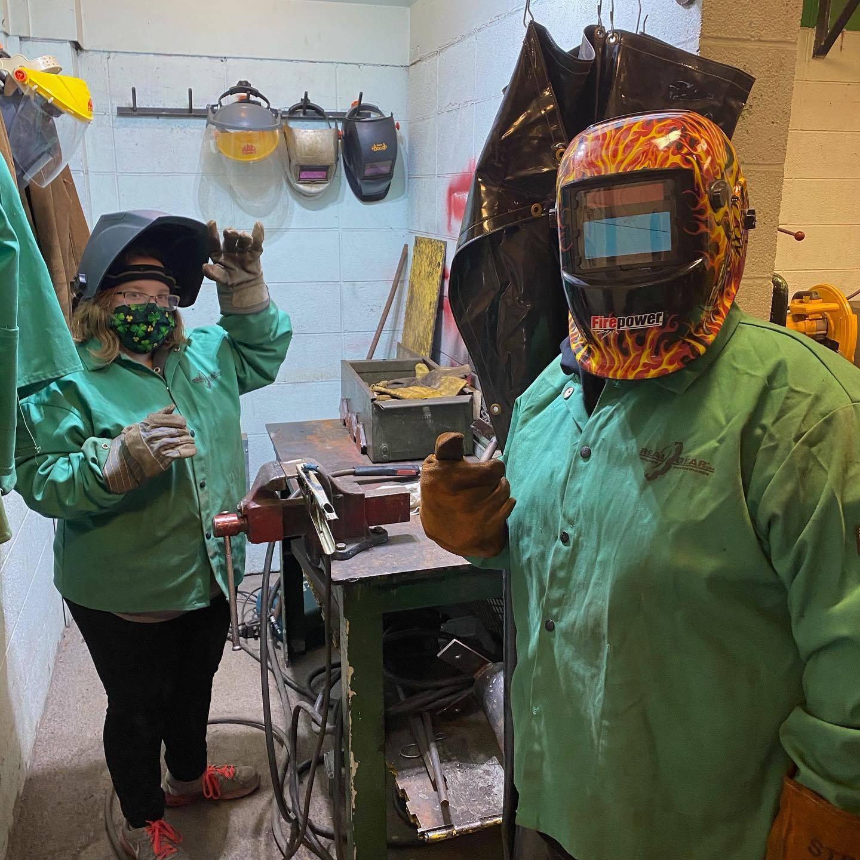 middle school students welding