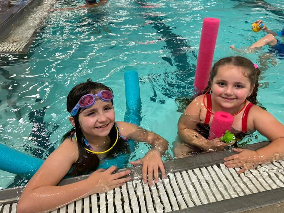 Two young girls in a swimming pool