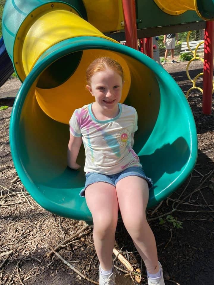 Girls on playground slide