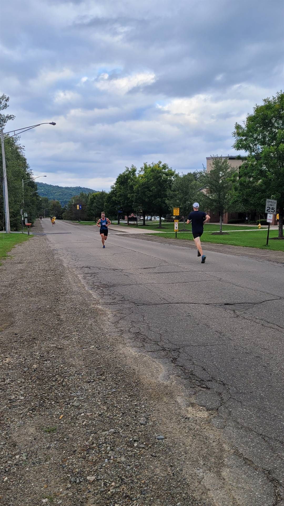 various people running on the street during the 5K race