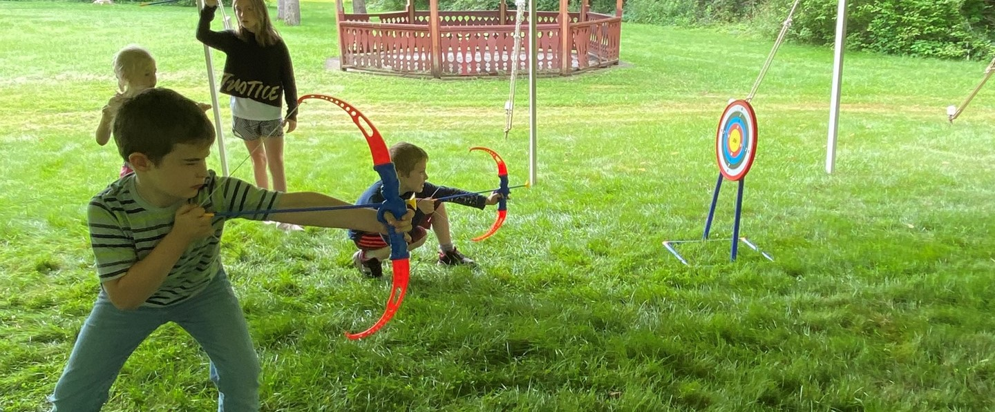 two young boys with bows and arrows