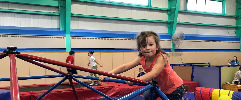 girl playing on jungle gym