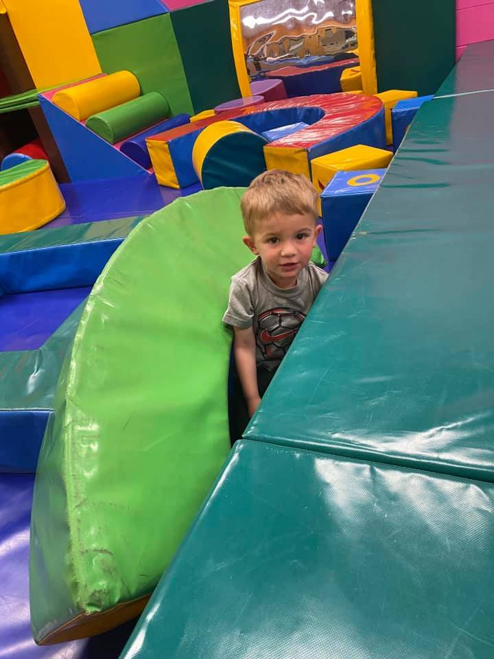 boy in adventure center playing