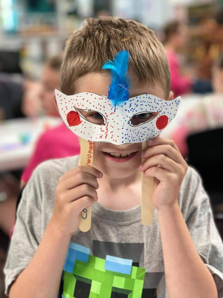 Boy with craft mask on
