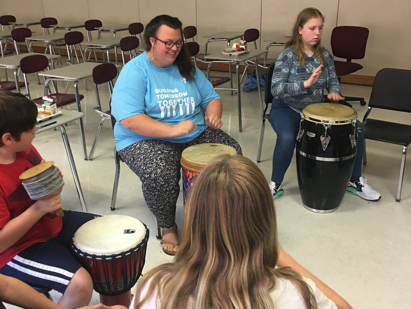 middle school students drumming on drums