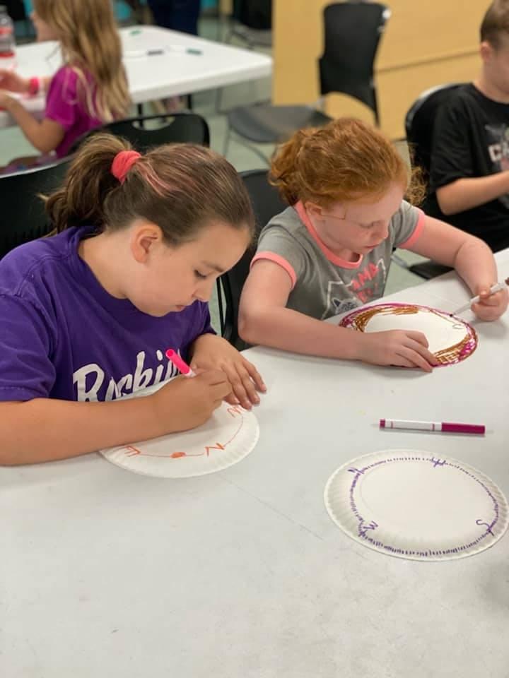 girls working on crafts