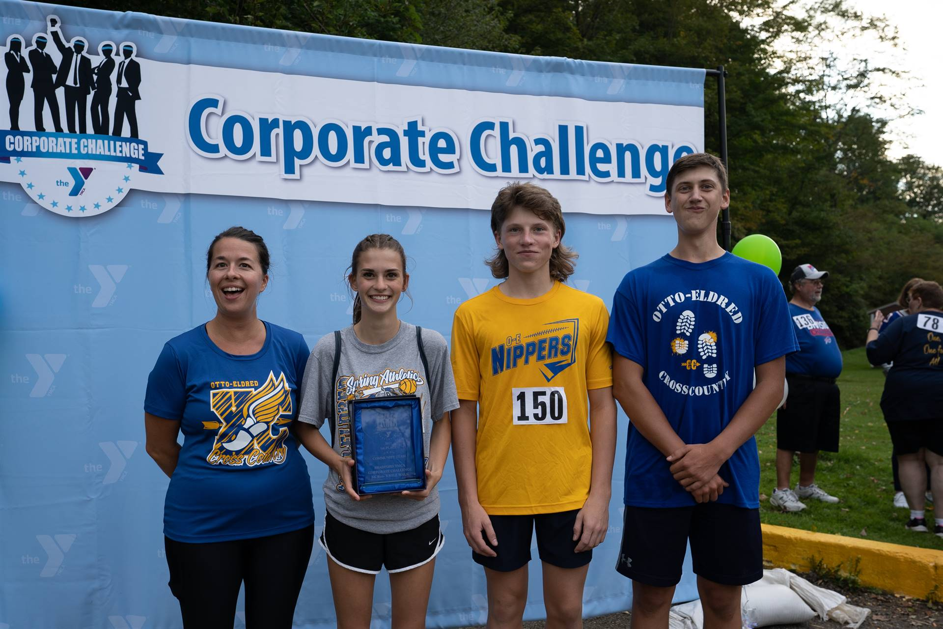 family in front of corporate challenge banner