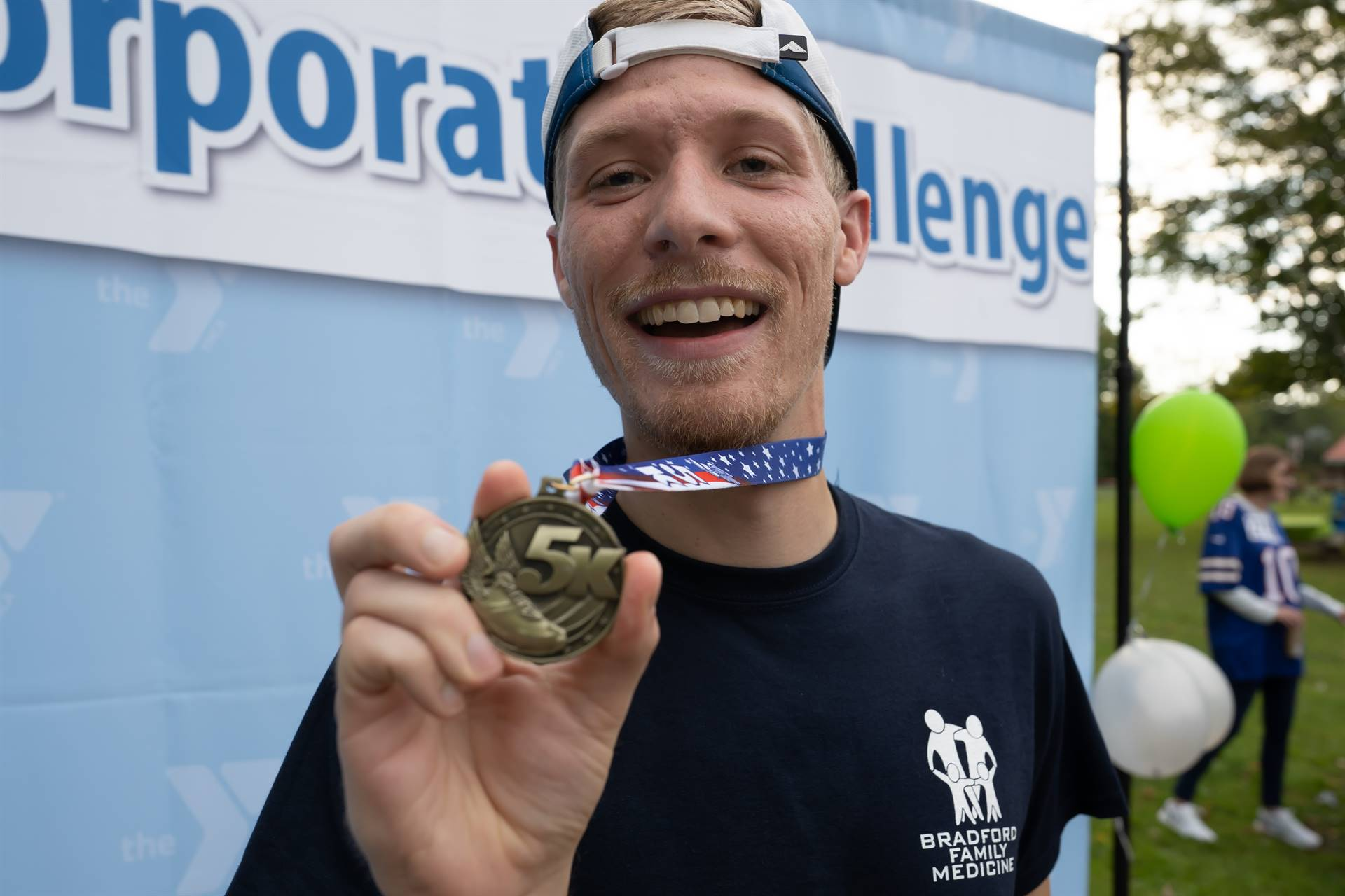 man holding up medal