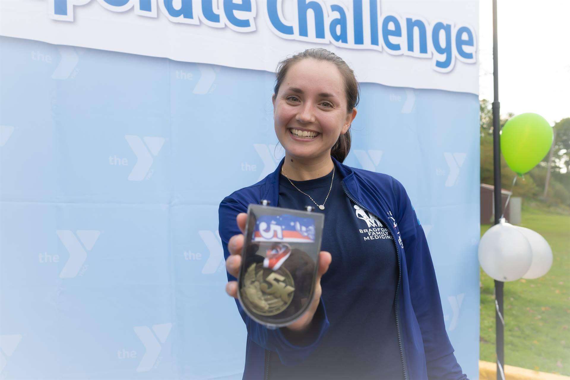 fastest female runner holding up award