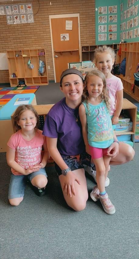 teacher with three small children