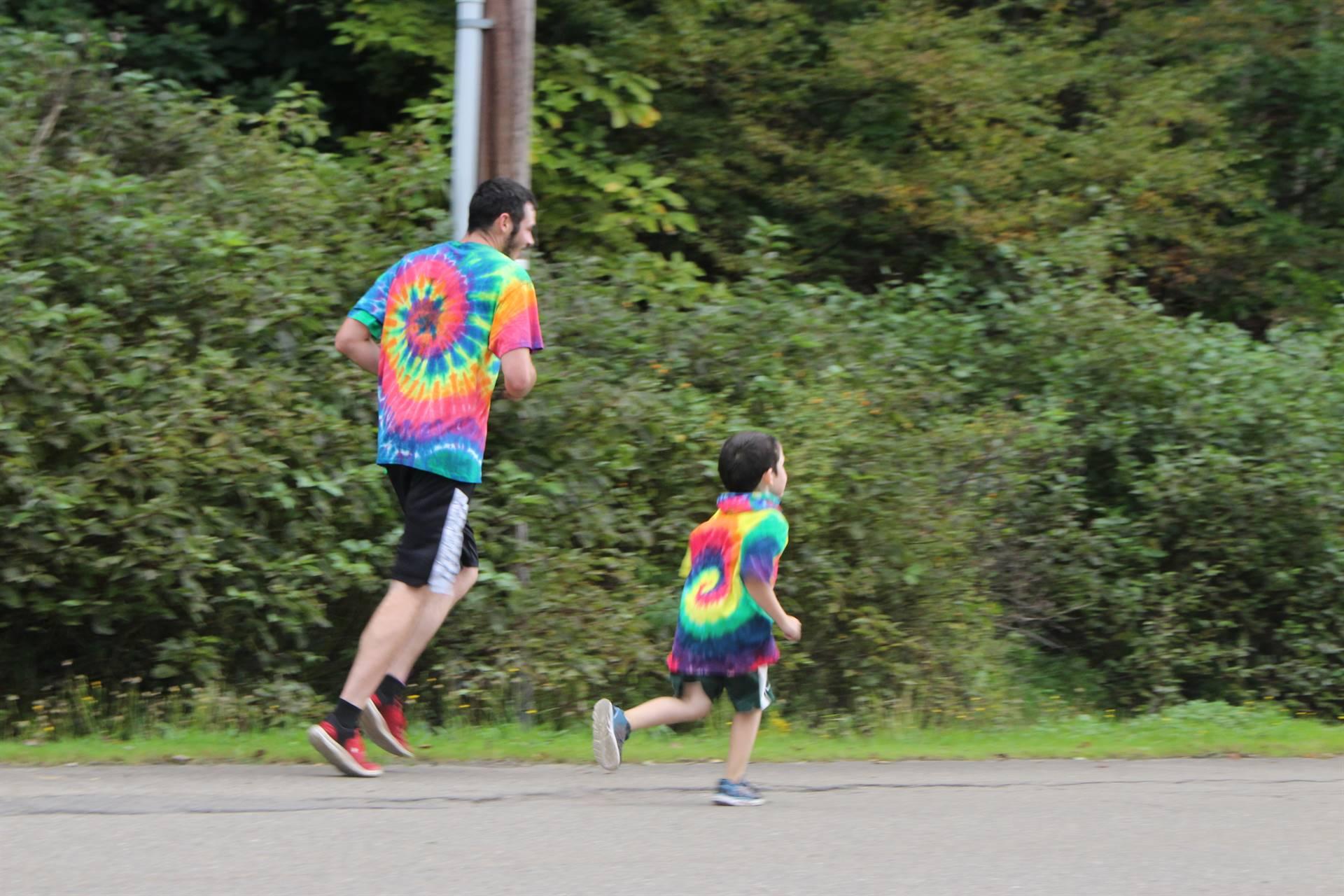 boy running with dad