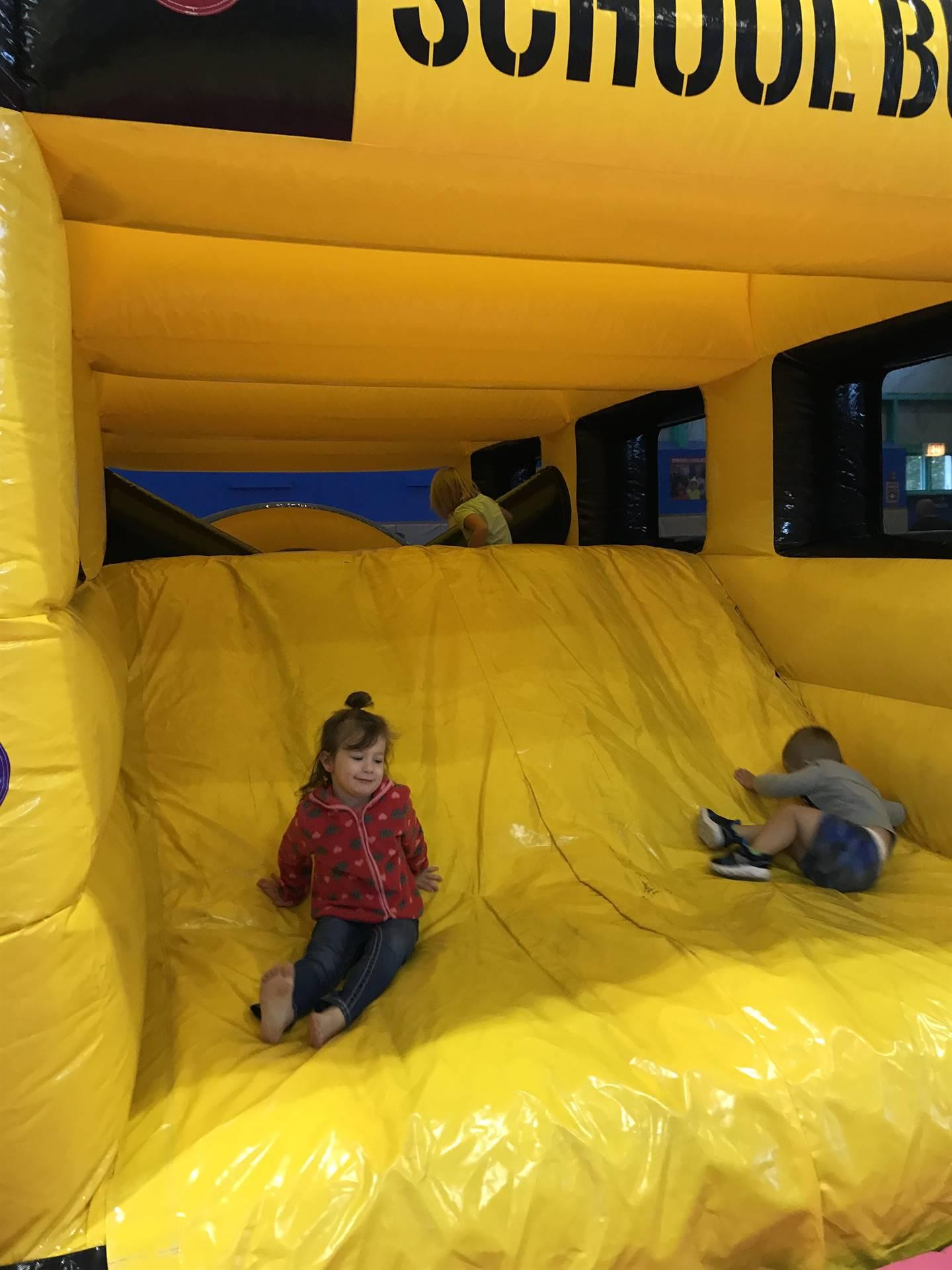 kids on inflatable school bus