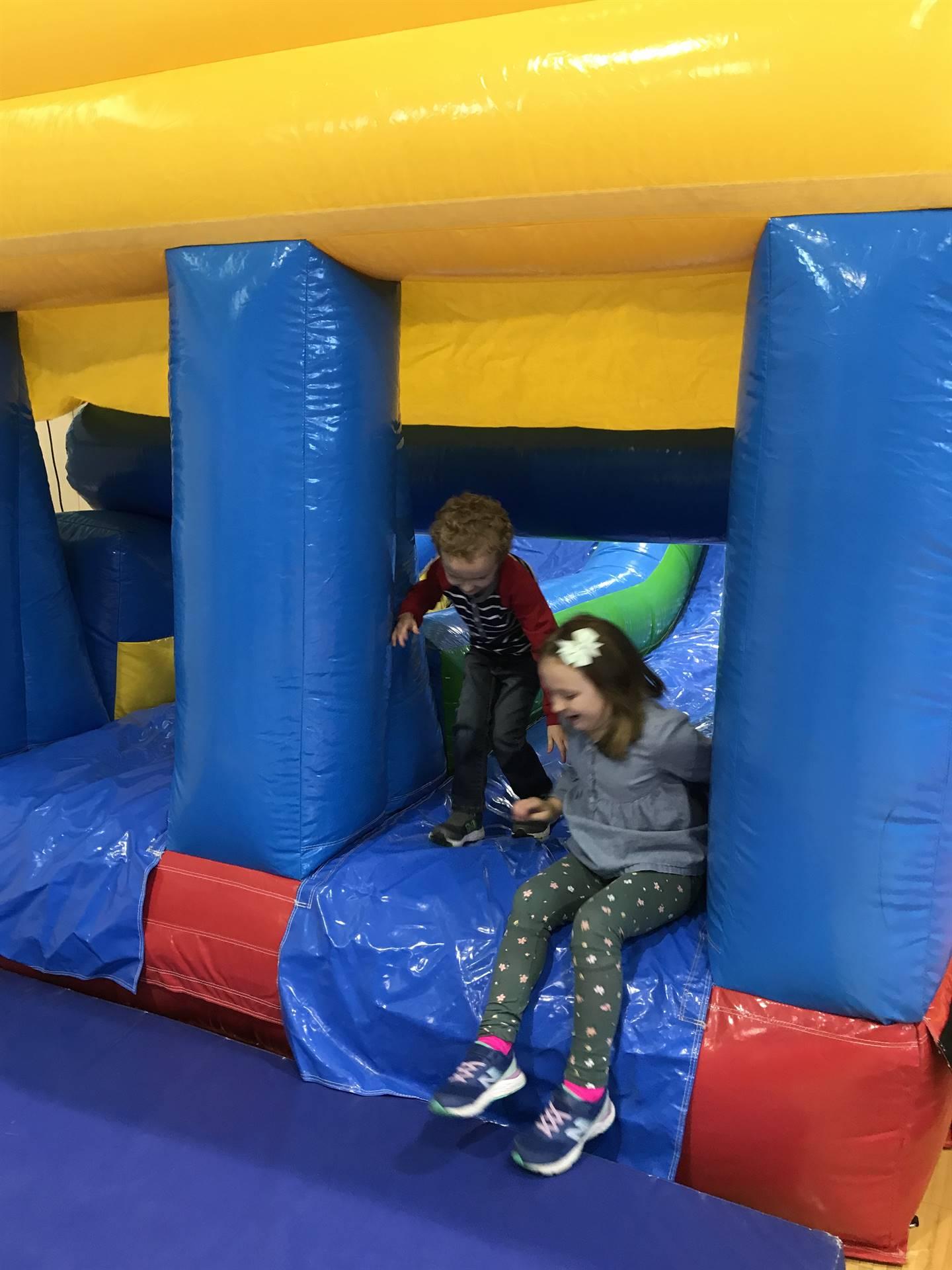 kids on inflatable slide