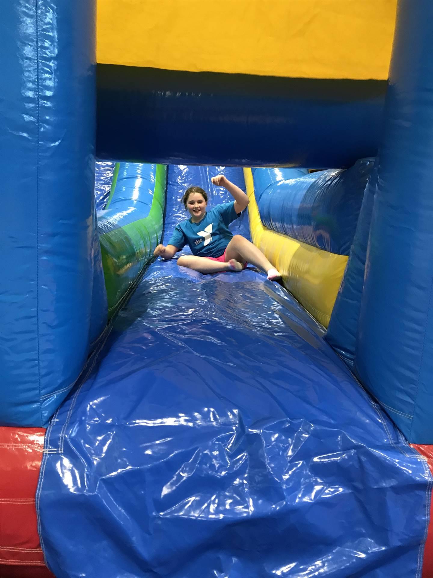 girl on inflatable slide