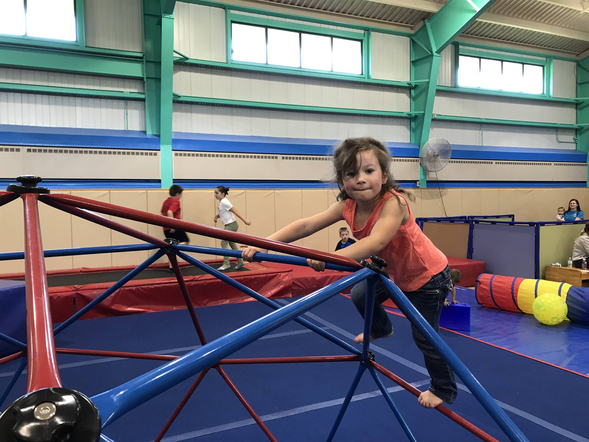 girl climbing on jungle gym